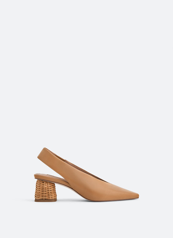 Heeled leather mules with straw design