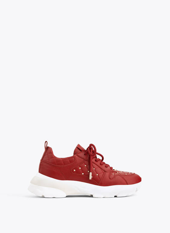 Red studded leather trainers
