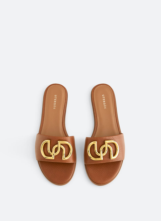 Flat leather sandals with logo