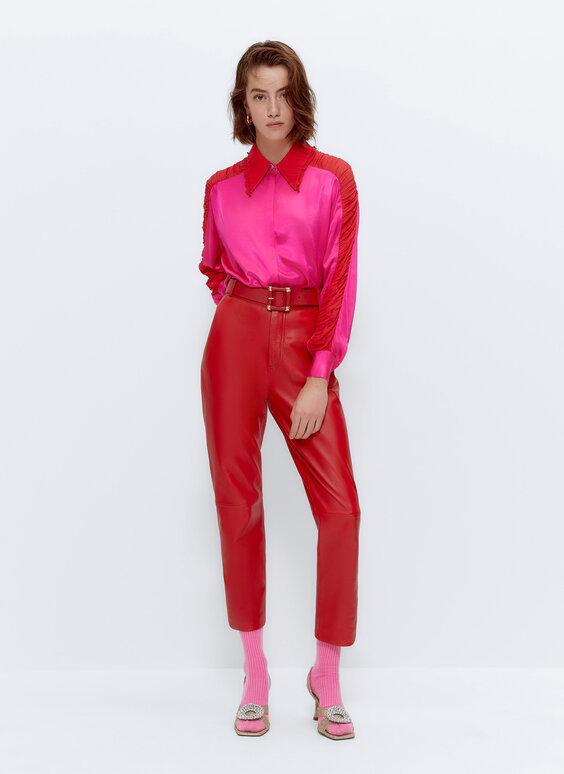 Narančaste kožne hlače