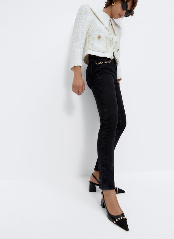 Skinny trousers with chain detail