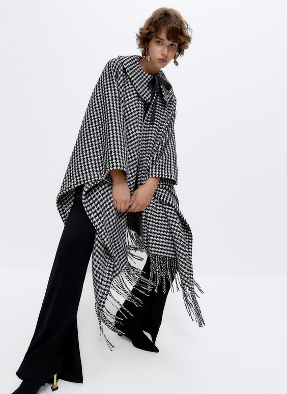 Fringed cape with detachable detail