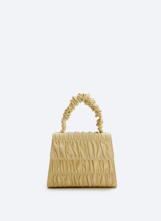 Leather bag with double pleats
