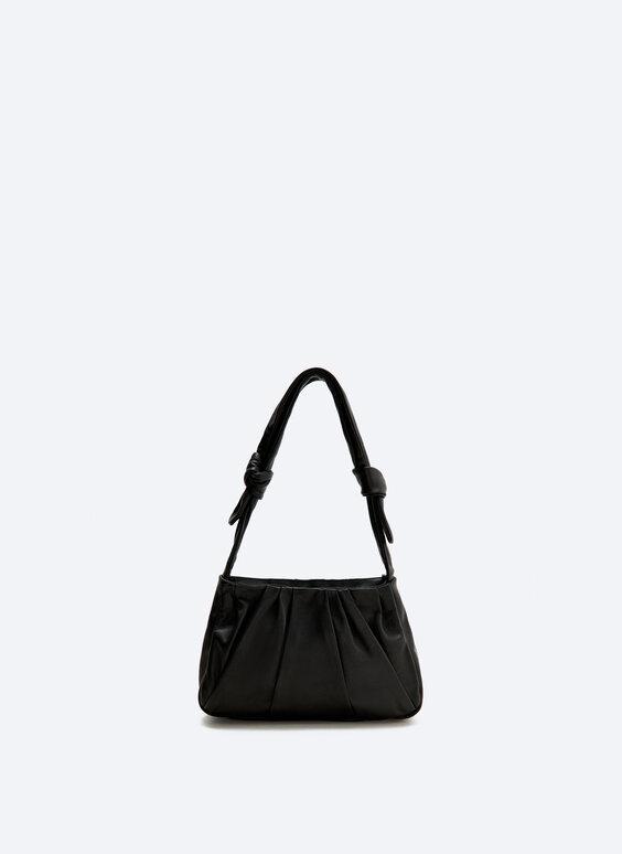 Adjustable knotted bag