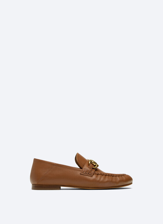 Gathered leather loafers with decoration