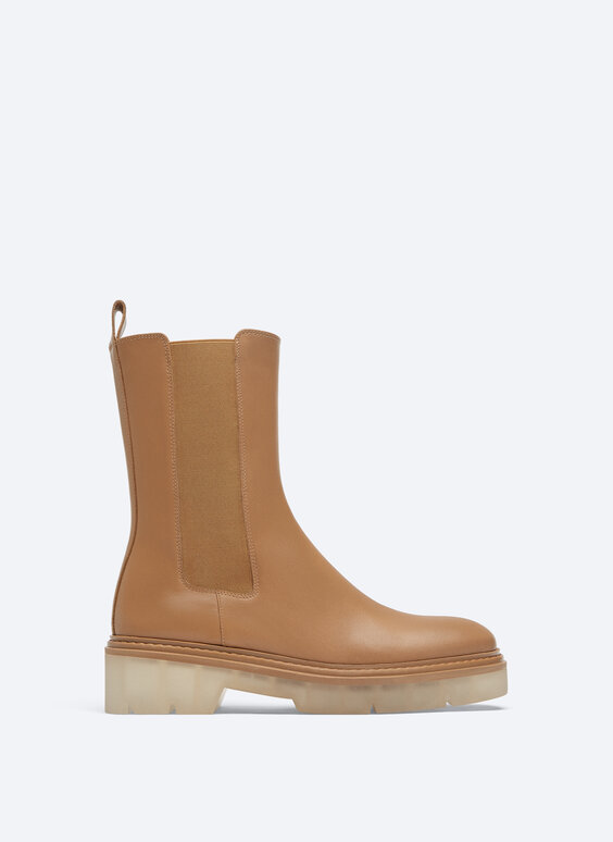 Leather stretch ankle boots with translucent sole