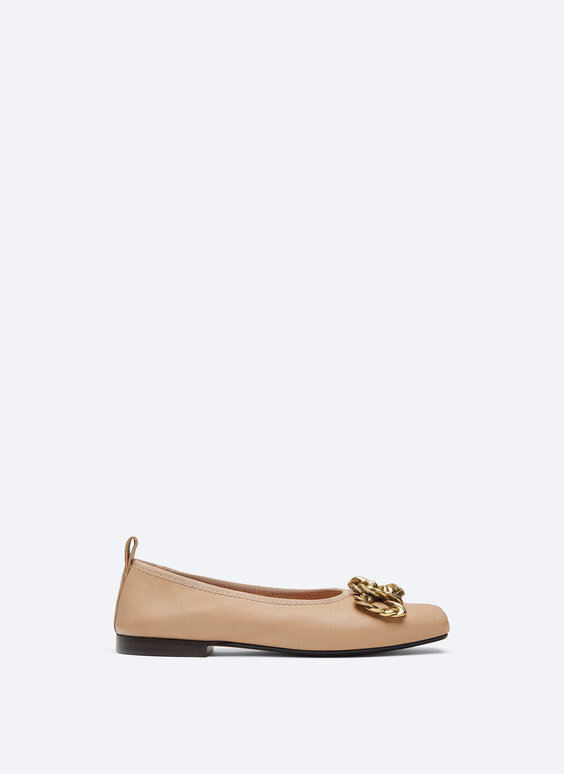 Leather ballet flats with decorative piece