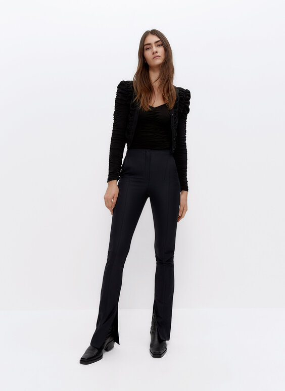 Stretch trousers with slit