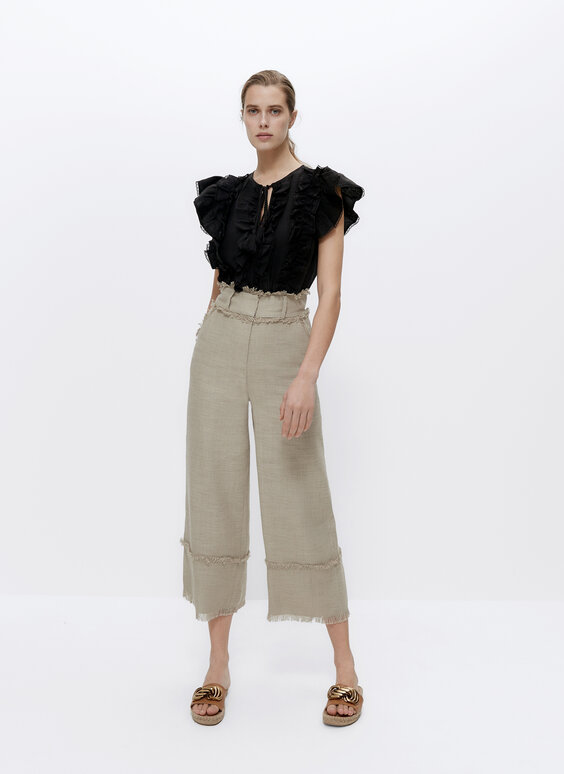 Lanene hlače s iskrzanim detaljem