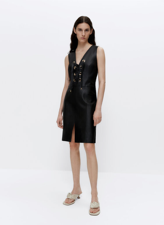 Leather dress with eyelets