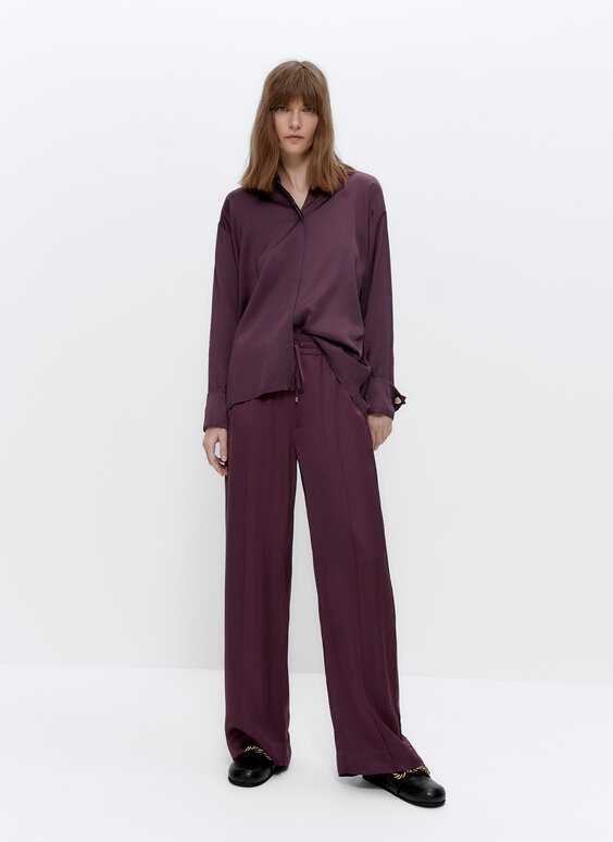 Satin trousers with seams