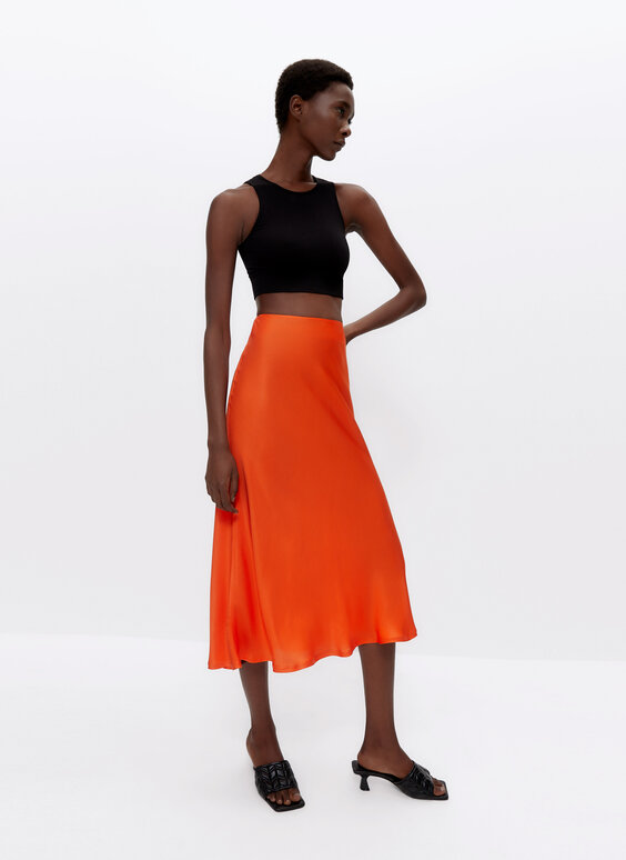 Orange skirt with bias-cut