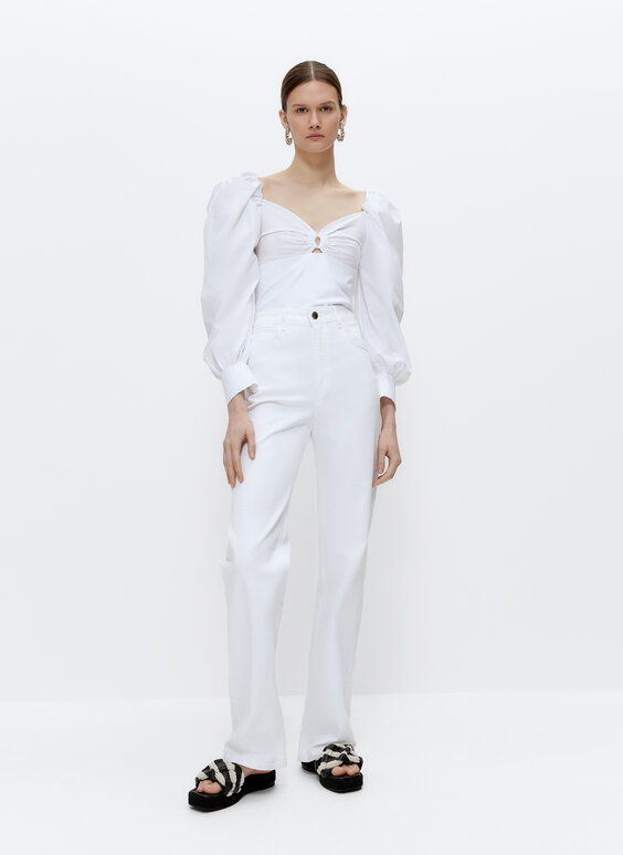 Top with poplin sleeves and ring detail