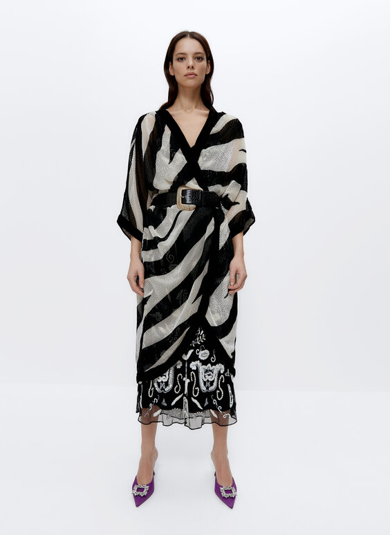 Embellished black and white poncho