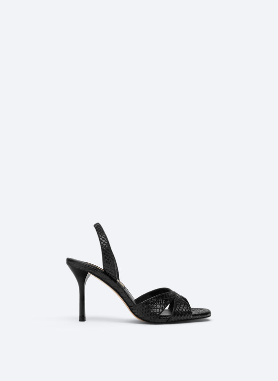 High-heel sandals in embossed leather