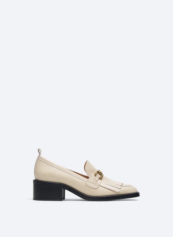 Leather heeled loafers with kiltie detail